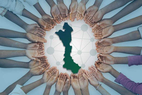 A unique image of a large group of children of East African descent showing their hands in a circular pattern. This could be as interpreted as in need of help, or asking for assistance.
